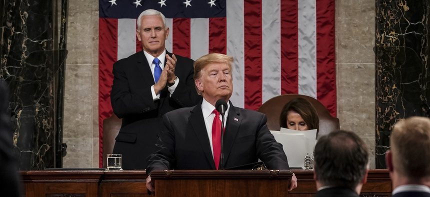 President Donald Trump gives his State of the Union address to a joint session of Congress, Tuesday, Feb. 5, 2019, at the Capitol in Washington, as Vice President Mike Pence, left, and House Speaker Nancy Pelosi look on.