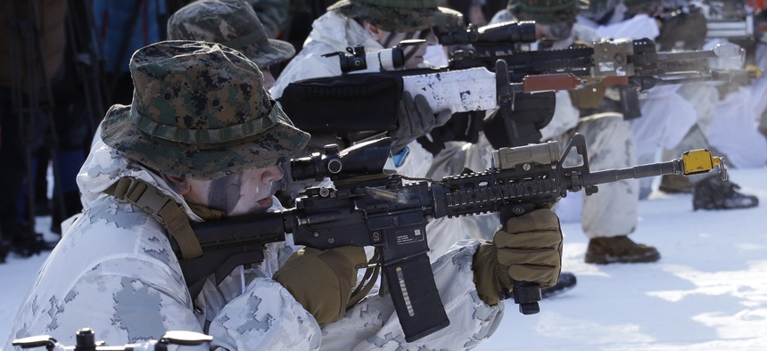 South Korean and U.S. Marines from III Marine Expeditionary Force from Okinawa, Japan, fire their machine guns during their joint military winter exercise in Pyeongchang, South Korea, Tuesday, Dec. 19, 2017.