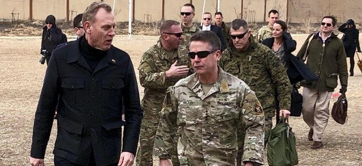 Acting Defense Secretary Pat Shanahan, left, arrives in Kabul, Afghanistan, Monday morning, Feb. 11, 2019, to consult with Army Gen. Scott Miller, right, commander of U.S. and coalition forces, and senior Afghan government leaders.