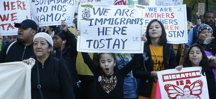 Immigrants and supporters gather 3,000 strong at Columbus Circle to protest & march against President Donald Trump's proposed immigration policies in New York City November 13, 2016.