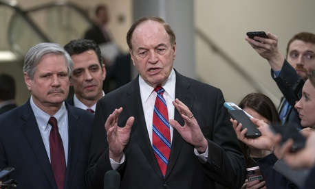 From left, Sen. John Hoeven, R-N.D., Rep. Tom Graves, R-Ga., and Sen. Richard Shelby, R-Ala., the top Republican of bipartisan bargainers working to avoiding another government shutdown, speak with reporters in Washington on Feb. 6, 2019.