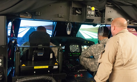Pilots assigned to the 25th Combat Aviation Brigade, 25th Infantry Division, receive their first look and hands-on-experience with the new UH-60M Black Hawks on the Transportable Black Hawk Operations Simulator, Jan. 14, 2014.