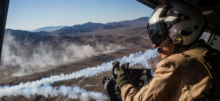 U.S. Marine Lance Cpl. Joseph Krieter looks from a UH-1Y Venom helicopter during an Integrated Training Exercise at Marine Corps Air Ground Combat Center Twentynine Palms, California, Nov. 9, 2018.
