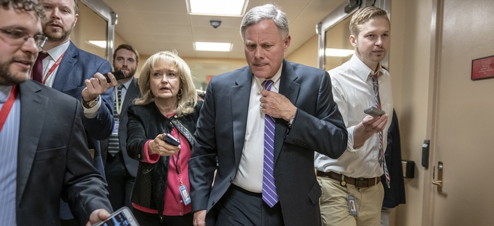 Senate Intelligence Committee Chairman Richard Burr, R-N.C., walks to the Senate as reporters ask questions, at the Capitol in Washington, Tuesday, Feb. 12, 2019.