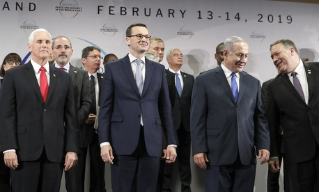 In this Feb. 14, 2019 photo, United States Vice President Mike Pence, Prime Minister of Poland Mateusz Morawiecki, and Israeli Prime Minister Benjamin Netanyahu stand on a podium at a conference in Warsaw, Poland.