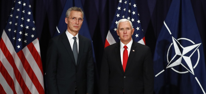 United States Vice President Mike Pence, right, and NATO's Secretary General Jens Stoltenberg, left, pose for media during a bilateral meeting at the Munich Security Conference in Munich, Germany, Saturday, Feb. 16, 2019.