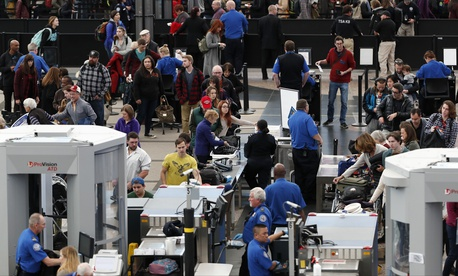 Travelers wait in long lines to pass through a security checkpoint in Denver International Airport Wednesday, Nov. 21, 2018, in Denver.