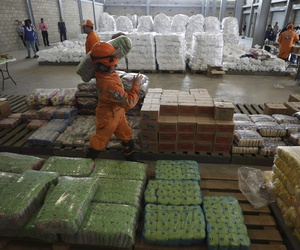 Venezuelan volunteers, Colombian firefighters and rescue workers prepare USAID humanitarian aid for storage at a warehouse next to the Tienditas International Bridge, near Cucuta, Colombia, on the border with Venezuela, Friday, Feb. 8, 2019.