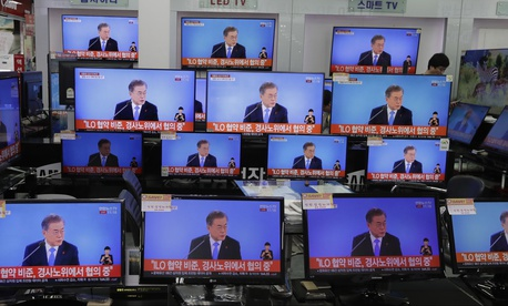 TV screens show the live broadcast of South Korean President Moon Jae-in's New Year press conference at an electronic shop in Seoul, South Korea, Thursday, Jan. 10, 2019.