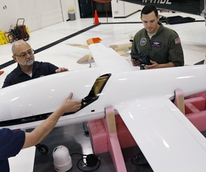 In this May 19, 2016, photo, Joe Cummings, from left, Mike Lukens and Mike Toland, of National Security Technologies, a contractor for the National Nuclear Security Administration, work on a drone at the Remote Sensing Laboratory in Las Vegas.