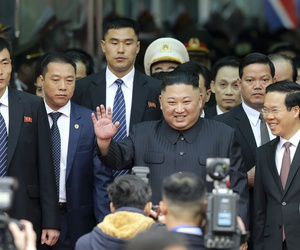 North Korean leader Kim Jong Un waves upon arrival by train in Dong Dang in Vietnamese border town Tuesday, Feb. 26, 2019