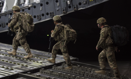 U.S. Army soldiers board a U.S. Air Force C-17 Globemaster III from the 816th Expeditionary Airlift Squadron for transport while the aircraft and its crew conduct combat airlift operations for U.S. and coalition forces in Iraq and Syria, Nov. 11, 2017.