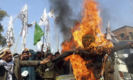 Pakistani protesters burn an effigy of Indian Prime Minister Narendra Modi during an anti-Indian rally in Peshawar, Pakistan, Thursday, Feb. 28, 2019.