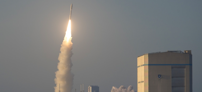 A United Launch Alliance Atlas V rocket launches into the air from Launch Complex 41 during the Air Force Space Command 11 launch at Cape Canaveral Air Force Station, Florida, April 14, 2018.