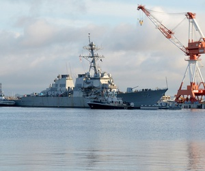 Valiant-class yard tugboats Seminole and Menominee assist Arleigh Burke-class guided-missile destroyer USS Fitzgerald as it moves toward Dry Dock 4 in 2017.
