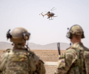 Train, Advise and Assist Command-Air operations advisors observe an MD-530 during the final exercise of the Afghan Tactical Air Coordinator course in Kabul in 2018.