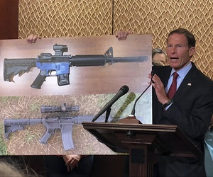 Sen. Edward Markey, D-Mass., left, and Sen. Richard Blumenthal, D-Ct., display a photo of a plastic gun on Tuesday, July 31, 2018, on Capitol Hill in Washington.