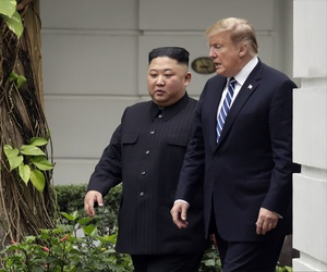 President Donald Trump and North Korean leader Kim Jong Un take a walk after their first meeting at the Sofitel Legend Metropole Hanoi hotel, Thursday, Feb. 28, 2019, in Hanoi.