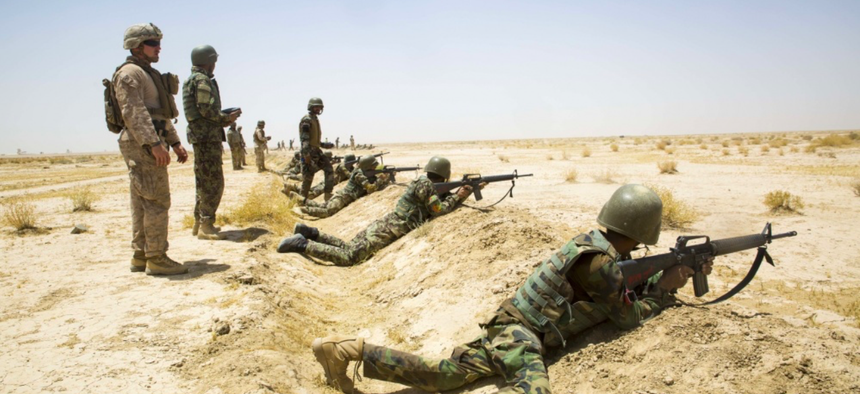 Afghan National Army (ANA) 215th Corps soldiers shoot simulated enemy targets during a live-fire range supervised by ANA instructors and U.S. Marine Corps advisors with Task Force Southwest at Camp Shorabak.