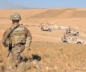 U.S. Soldiers observe Turkish forces in the distance during a patrol outside Manbij, Syria, Aug. 19, 2018.