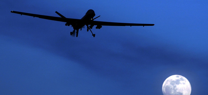 In this Jan. 31, 2010, file photo, an unmanned U.S. Predator drone flies over Kandahar Air Field, southern Afghanistan, on a moon-lit night.