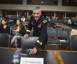 Army Lieutenant General Paul Nakasone arrives at the witness table to appear before the Senate Armed Services Committee to discuss his qualifications as nominee to be National Security Agency Director and U.S. Cyber Command Commander, during a hearing on