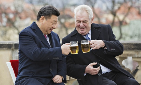 Chinese President Xi Jinping, left, and Czech Republic's President Milos Zeman, right, clink glasses of beer on the terrace of the Strahov Monastery in Prague, Czech Republic, Wednesday, March 30, 2016.