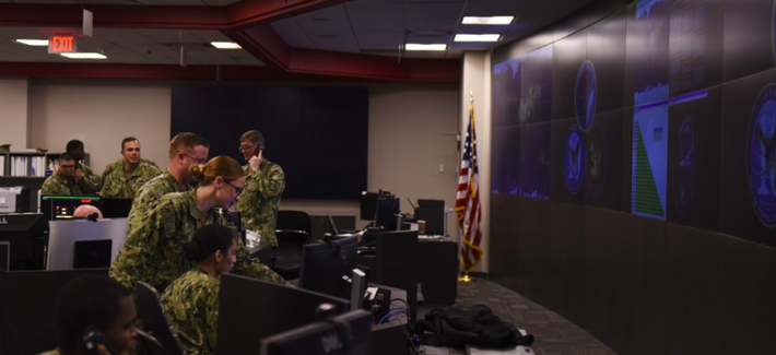 Sailors stand watch in the Fleet Operations Center at the headquarters of U.S. Fleet Cyber Command/U.S. 10th Fleet (FCC/C10F).