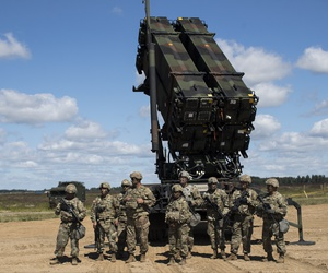"Members of US 10th Army Air and Missile Defense Command stands next to a Patriot surface-to-air missile battery during the NATO exercise ""Tobruq Legacy 2017"" at the Siauliai airbase near Vilnius, Lithuania, July 20, 2017."