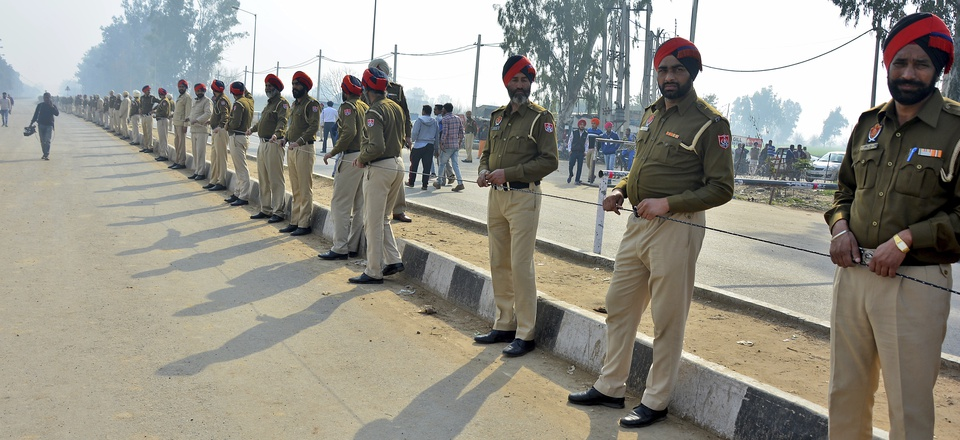 Indian policemen stand guard as they prepare to receive Indian pilot at India Pakistan border at Wagah, 28 kilometers (17.5 miles) from Amritsar, India, Friday, March 1, 2019.