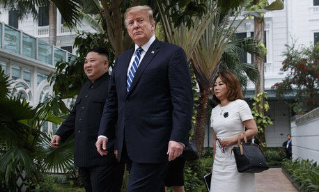 President Donald Trump and North Korean leader Kim Jong Un take a walk at the Sofitel Legend Metropole Hanoi hotel, Thursday, Feb. 28, 2019, in Hanoi.