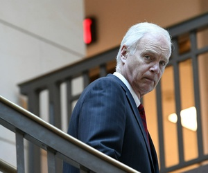 Sen. Ron Johnson, R-Wis., questions whether postal workers should be able to engage in collective bargaining.