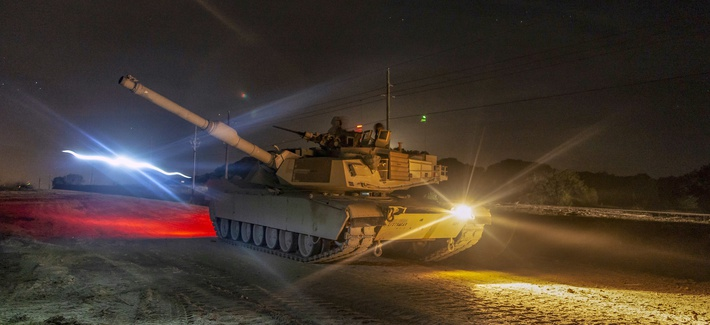A U.S. Army M1 abrams tank works in unison with tanks from the Polish armed forces during live-fire and maneuvering training in Poland, Nov. 14, 2018, as part of joint training exercise Anakonda.