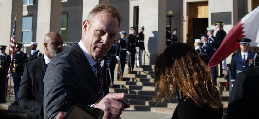 Acting Secretary of Defense Patrick Shanahan talks to media before the arrival of Qatari Minister of Defense Khalid bin Mohammed al-Attiyah, at the Pentagon, Tuesday, March 12, 2019.