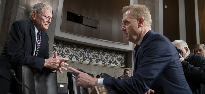 Senate Armed Services Committee Chairman Jim Inhofe, R-Okla., left, welcomes Acting Defense Secretary Patrick Shanahan to testify on the Department of Defense budget, on Capitol Hill in Washington, Thursday, March 14, 2019.