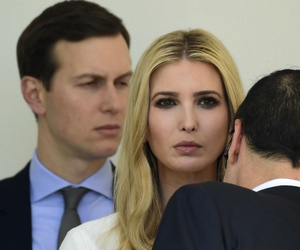 Ivanka Trump, center, talks with Treasury Secretary Steven Mnuchin, right, as her husband, White House senior adviser Jared Kushner, looks on. The couple received security clearances despite objections from intelligence officials.