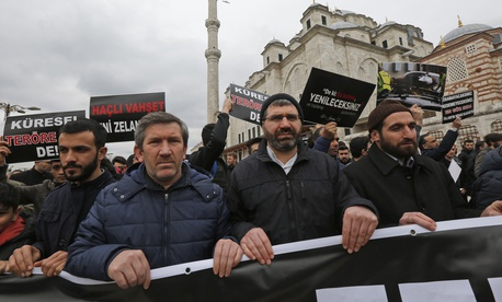 Demonstrators march after the mosque attacks in New Zealand, during a protest in Istanbul, Friday, March 15, 2019.