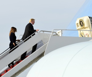 President Donald Trump, first lady Melania Trump, and their son Barron Trump walk up the steps of Air Force One at Palm Beach International Airport in West Palm Beach, Fla., Sunday, Nov. 25, 2018.