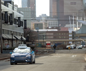 """One of Ford's """"Argo AI"""" autonomous vehicles navigates through the strip district near the company offices in Pittsburgh."""
