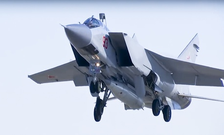 In this photo made from the footage taken from Russian Defense Ministry official web site on Sunday, March 11, 2018, a MiG-31 fighter jet of the Russian air force carrying the new Kinzhal hypersonic missile takes off from an air base in southern Russia.