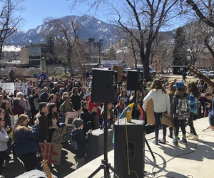 Students and other supporters listen to performers, March 15, 2019, in Boulder, Colorado as they take part in a rally demanding action against climate change. The event was one of many protests worldwide organized by word of mouth and social media.