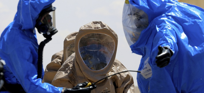 U.S. and Jordanian forces respond to scenarios involving the simulated detection of chemical, biological or nuclear materials in a joint drill on Sunday, April 22, 2018, in a training area near the town of Zarqa, east of Jordan's capital of Amman.