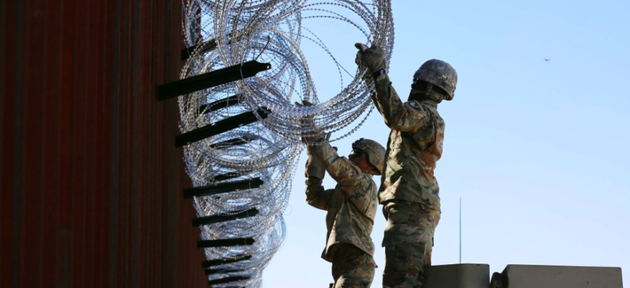 Soldiers assigned to 87th Sapper Company place concertina wire on a border wall near Douglas, Arizona, Nov. 15, 2018.