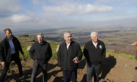 Israeli Prime Minister Benjamin Netanyahu, center, Republican U.S. Senator Lindsey Graham, second left, and U.S. Ambassador to Israel David Friedman, right, visit the border between Israel and Syria at the Israeli-held Golan Heights, March 11, 2019.