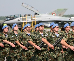 Bulgarian special forces soldiers parade walk in front of the Mig-29 jet fighter, during an open air show in the military air base of Graf Ignatievo east of the Bulgarian capital Sofia, Friday, June, 1, 2007.