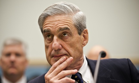 FBI Director Robert Mueller listens as he testifies on Capitol Hill in Washington, Thursday, June 13, 2013, as the House Judiciary Committee held an oversight hearing on the FBI.