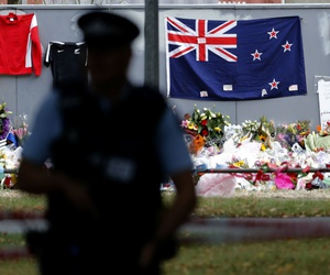 A policeman stands guard near the Al Noor mosque during Friday prayers at Hagley Park in Christchurch, New Zealand, March 22.