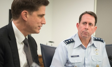 DOD Chief Information Officer Dana Deasy, left, and the Director of the Joint Artificial Intelligence Center, Lt. Gen. Jack Shanahan, hold a round table meeting at the Pentagon on Feb. 12, 2019.