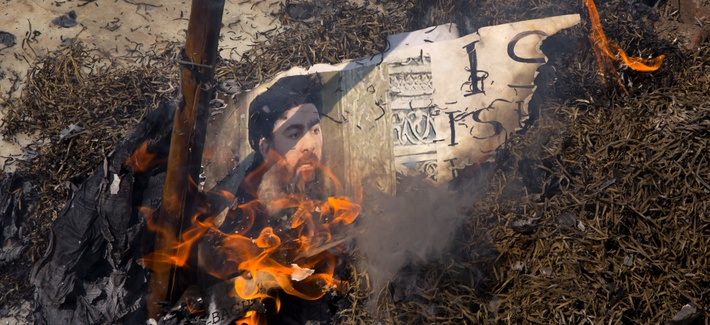 Shiite Muslims burn an effigy of the leader of the Islamic State group, Abu Bakr al-Baghdadi during a protest in New Delhi, India, Friday, June 9, 2017.