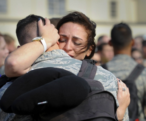 A woman hugs her husband on the tarmac at Minot Air Force Base, N.D, Sept. 11, 2017.